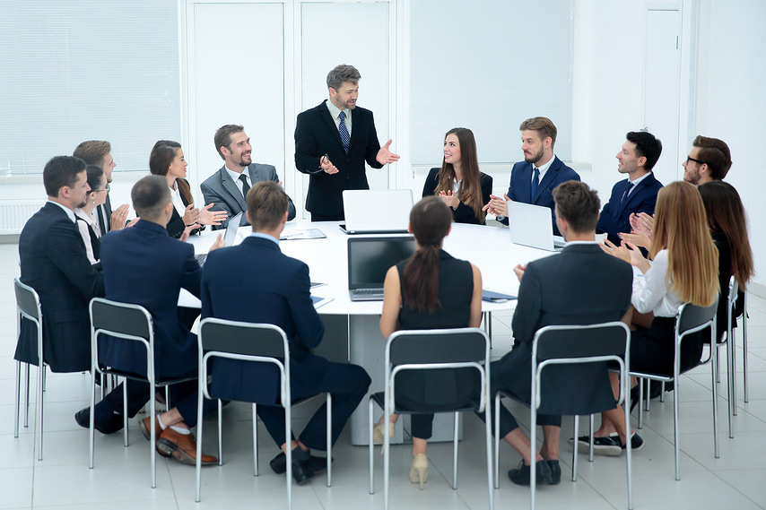 Business group greets leader with clapping and smiling